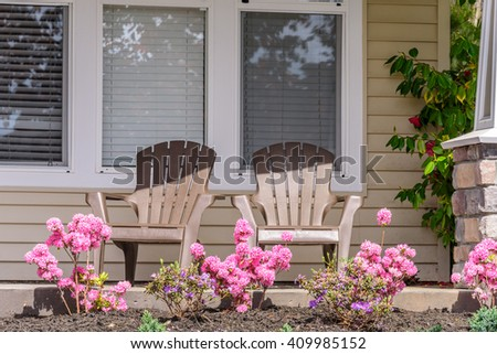 Two chairs at outdoor landscape garden in North Vancouver, British Columbia, Canada. - stock photo