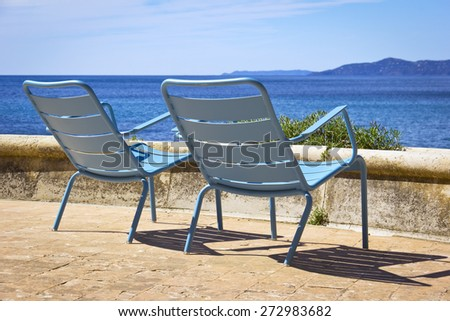 Two Chairs at the beach. Was seen in the South of France. - stock photo