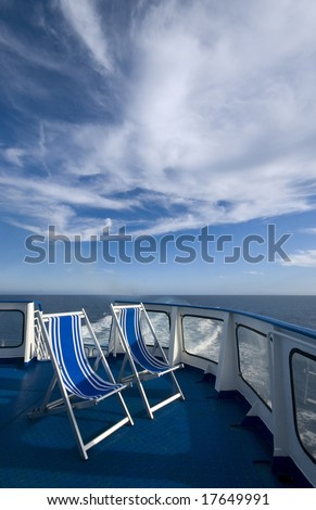 two chairs deck chairs on a cruise ship - stock photo