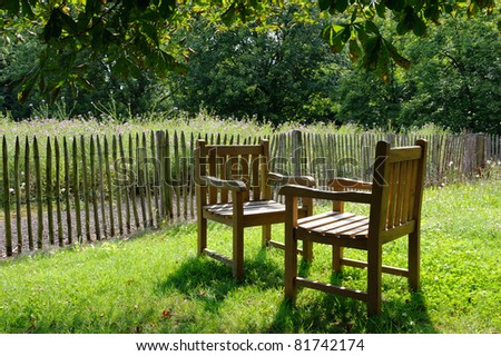 Two chairs exposed at sunlight on the backyard - stock photo