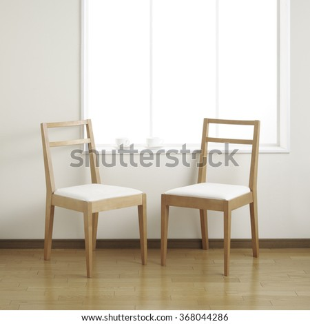 Two chairs in the room with coffee cup - stock photo