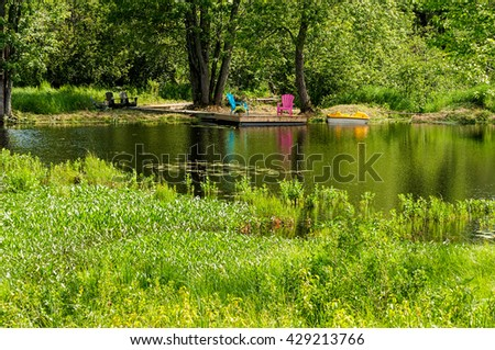 Two chairs on a dock - stock photo