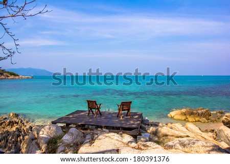 Two chairs on the beach in the wooden board - stock photo