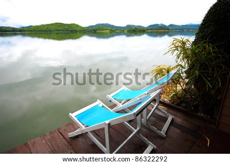 Two chairs on the beautiful lake - stock photo