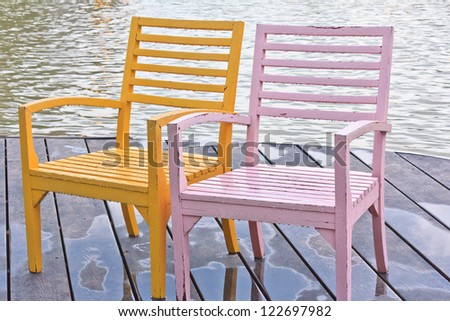 Two chairs on the waterfront - stock photo