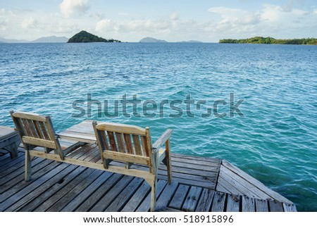 Two chairs on the wooden platform in Koh Mak island, Thailand
