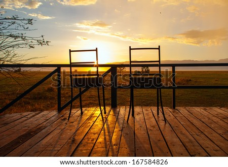 Two chairs with the sunset view in safari camp in Tanzania - stock photo