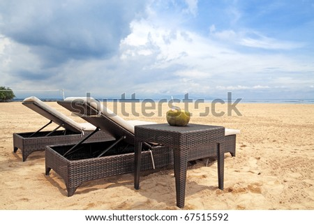 Two chaise lounges on the bank of the Indian ocean, island Bali, Indonesia - stock photo