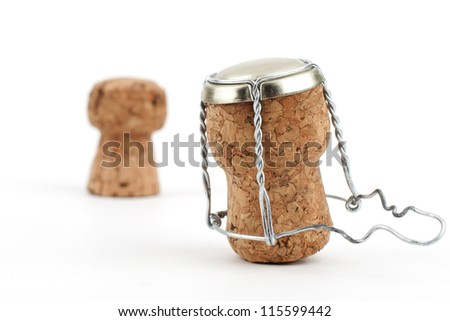 Two champagne corks close-up on white background - stock photo