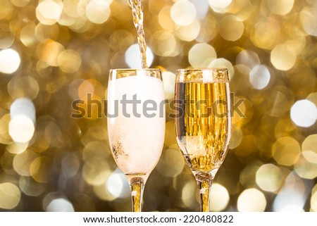Two champagne glass on christmas bokeh background Two champagne glass on christmas bokeh background
