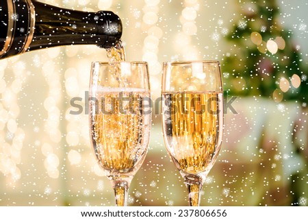 Two Champagne Glass With Stars And Snow On Defocused Background Living Room With Christmas Tree - stock photo