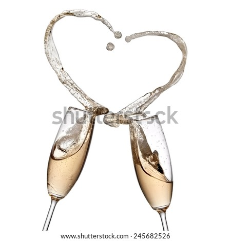 Two champagne glasses heart splash - stock photo