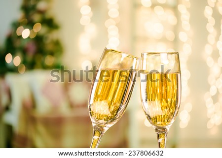 Two Champagne Glasses On Defocused Background Living Room With Christmas Tree - stock photo