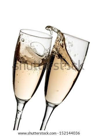 Two champagne glasses plash with bubbles - stock photo