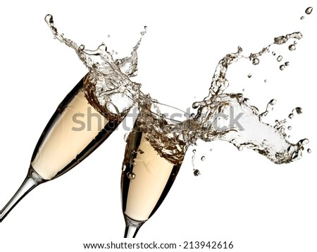 Two champagne glasses splash with drops - stock photo
