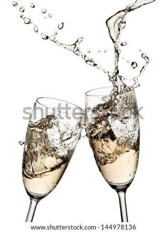 Two champagne glasses up with drops - stock photo