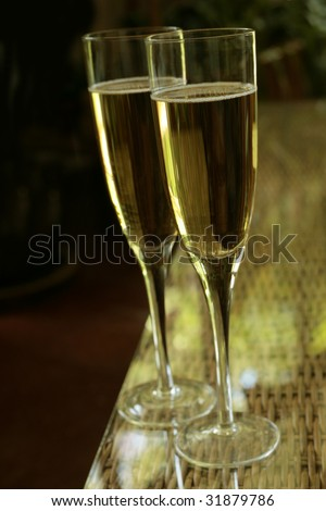 Two champagne glasses with nice dark background