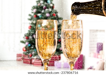 Two Champagne Glasses With Snow On Defocused Background Living Room With Christmas Tree