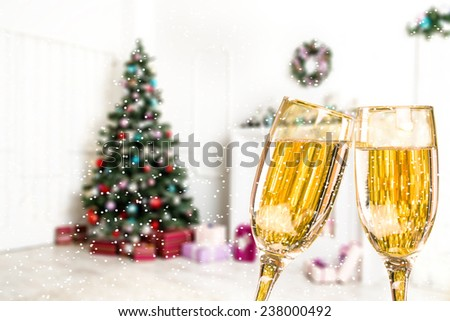 Two Champagne Glasses With Snow On Defocused Background Living Room With Christmas Tree - stock photo