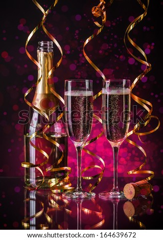 Two champagner glasses on glass table with bokeh background  - stock photo