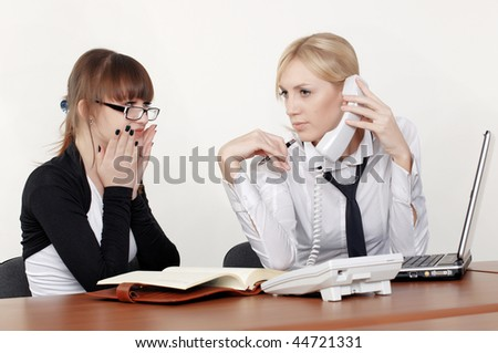 two charming business woman talking in office
