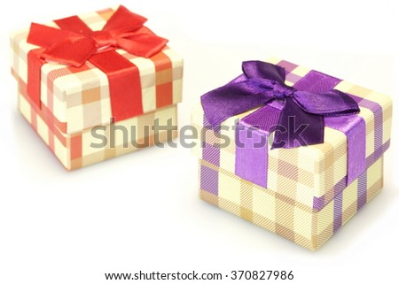 Two Checkered Gift Box With  Beige Brown Pattern, Red Violet Ribbon And Bow, Isolated On White Background,  Horizontal Image, Close Up, Front View - stock photo