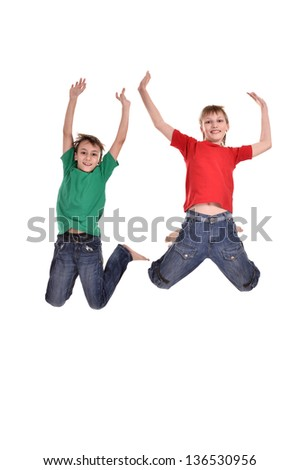 Two cheerful boys jumping on a white background