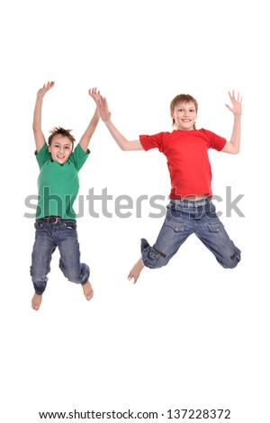 Two cheerful boys jumping on a white background - stock photo