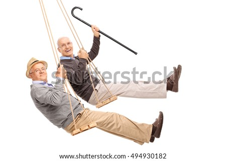 Two cheerful elderly men swinging on wooden swings isolated on white background