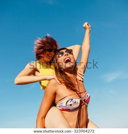 Two Cheerful Females Having Fun Outdoors - stock photo