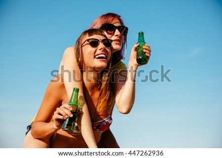 Two Cheerful Females Having Fun Outdoors