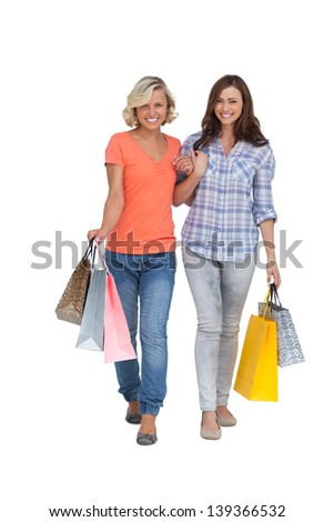 Two cheerful friends with shopping bags on white background