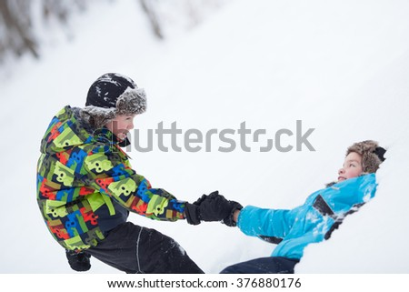 Two cheerful happy boys playing in winter park, outdoor - stock photo