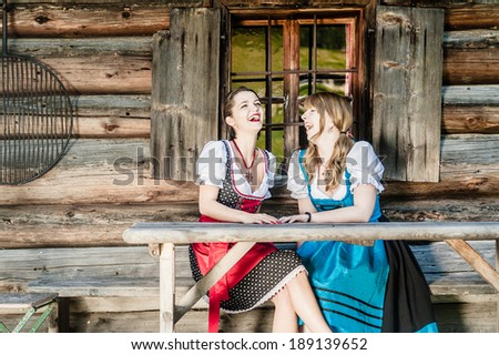 Two cheerful women in traditional austrian outfit