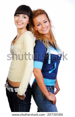 Two cheerful young  attractive girls. Studio shot on white - stock photo