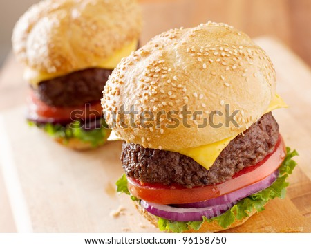 two cheeseburgers in natural light. - stock photo