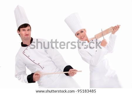 Two chefs having fun - stock photo