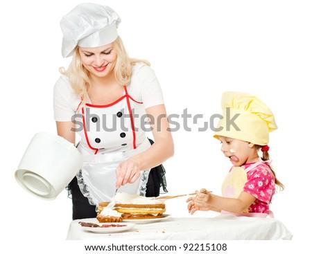 Two chefs rubs cream cake, white background - stock photo