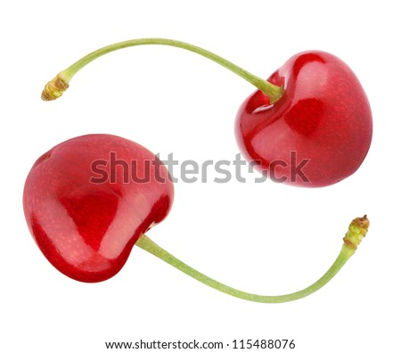 Two cherry berry fruits as yin yang symbol isolated on white - stock photo