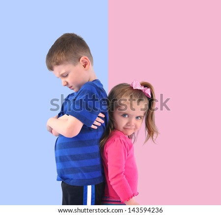 Two children are standing on a pink and blue divided background upset and unhappy for a discipline or gender concept. - stock photo