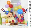 Two children at big birthday party - stock photo