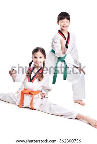 Two children athletes martial art taekwondo training - stock photo
