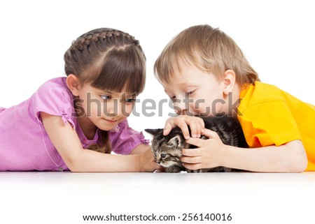 two children boy and girl playing with kitten - stock photo