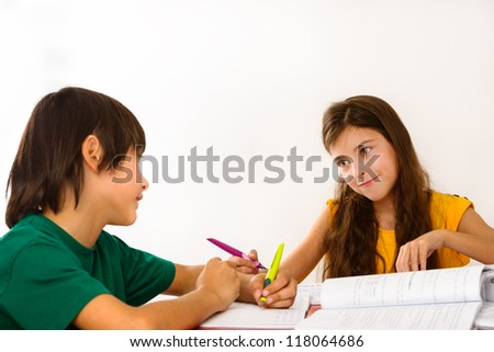 Two children doing their homework - stock photo