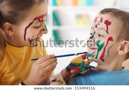 Two Children Drawing them self