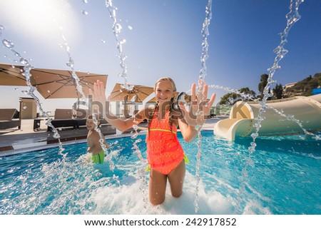 Two children having fun swimming pool stock photo for Obi easy pool