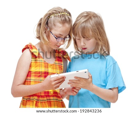 Two Children Having Fun with Digital Tablet - Isolated on White - stock photo