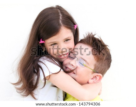 Two children hugging - stock photo