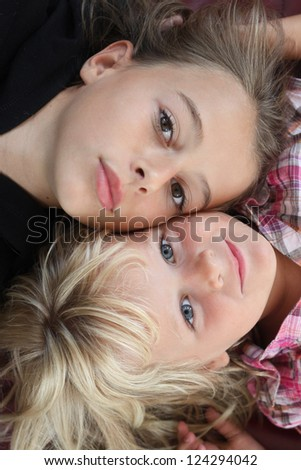 Two children looking at camera - stock photo