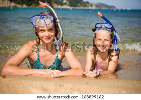 Two children lying on the beach and taken the rest after snorkeling - stock photo